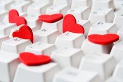 Coeurs sur le clavier Photos stock