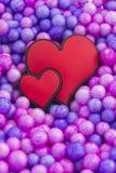 Coeurs sur le fond de colorfull Photo libre de droits