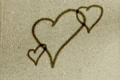 Coeurs sur le fond de Livre vert de vintage Photo libre de droits