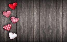 Coeurs sur le fond en bois Photographie stock libre de droits