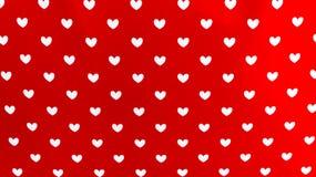 Coeurs sur le fond rouge Image libre de droits