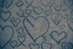 Coeurs sur le plancher poussiéreux Images stock