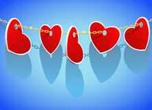 Coeurs sur un réseau d'or. Photos stock