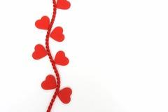 Coeurs sur une vigne de corde Photographie stock libre de droits