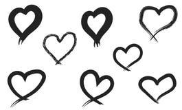 Coeurs tirés par la main réglés Aimez le symbole avec la peinture sèche de brosse, d'isolement photographie stock