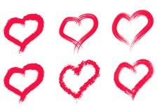 Coeurs tir?s par la main r?gl?s Aimez le symbole avec la peinture s?che de brosse, d'isolement photographie stock