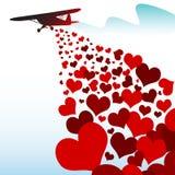 Coeurs tombant d'un avion Image libre de droits
