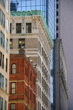 Coexistence. Old and new buildings line a city street Stock Image