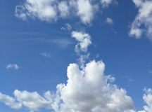 Dreamy fluffy clouds in blue sky stock photography