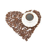 Cofe heart. A cup of coffe on a heart made by caffe beans Royalty Free Stock Photo