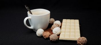 Cofe, Stack of Black and White Chocolate isolated on black background, place for text.  Royalty Free Stock Photography