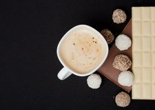 Cofe, Stack of Black and White Chocolate isolated on black background, place for text.  Royalty Free Stock Photo