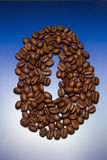 Cofee. Coffee grains on a dark blue gradient in the form of a circle Stock Photo