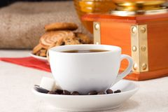 Cofee, beans, grinder and sweets. On sacking Royalty Free Stock Images