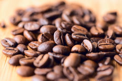 Cofee beans macro on wooden table Royalty Free Stock Photography