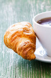 Cofee and croissant Stock Photos