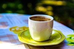 Cofee cup on table Stock Image