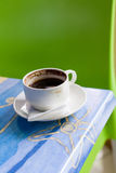 Cofee cup on a table Royalty Free Stock Photo
