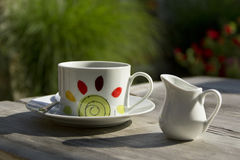 Cofee Cup On Wooden Table. In the garden Stock Image