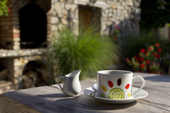 Cofee Cup On Wooden Table. Morning cofee cup on wooden table in a garden Royalty Free Stock Photo