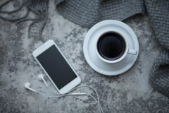 Cofee and mobile phone. Cup of cofee and mobile phone Stock Photos