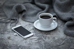 Cofee and mobile phone. Cup of cofee and mobile phone Stock Photo