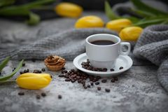 Cofee and yellow tulips. Cup of cofee and yellow tulips stock photos
