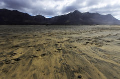 Cofete beach and dark volcanic mountains royalty free stock photo