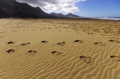 Cofete beach and dark volcanic mountains Stock Images