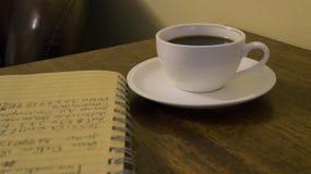 Coffe、笔记本和想法 库存图片