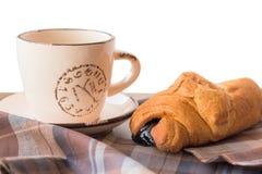 Coffe和新月形面包 免版税图库摄影