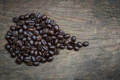 Coffe和木背景 免版税库存照片