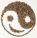 coffe豆的微笑的金jang面孔 库存照片