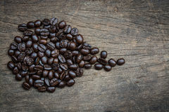 Coffe и деревянная предпосылка Стоковое фото RF