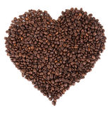 Coffe. E beans spread out in the form of a  heart Royalty Free Stock Image