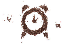 Coffe. E beans spread out in the form of a clock Stock Photos