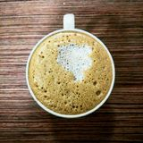 Coffe from above wooden desk morning coffee Royalty Free Stock Photography