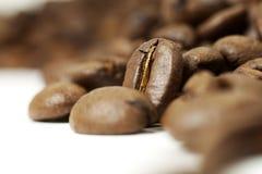 Coffe bean. Coffee bean standing in a heap, on white Stock Photo
