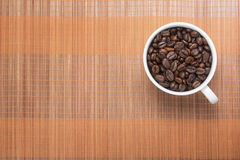 Coffe bean in cup Stock Photos