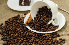 Coffe bean still life. Still life with coffee beans and coffee on the plate Royalty Free Stock Image