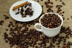 Coffe bean still life. Still life with coffee beans and coffee on the plate Royalty Free Stock Images