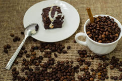 Coffe bean still life. Still life with coffee beans and coffee on the plate Stock Image