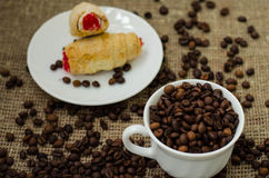 Coffe bean still life. Still life with coffee beans and coffee on the plate Stock Photography