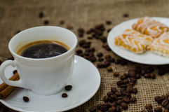 Coffe bean still life. Still life with coffee beans and coffee on the plate Royalty Free Stock Photos
