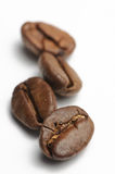 Coffe beans. Four Coffee beans on white background Royalty Free Stock Photo