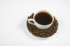 Coffe and beans. White coffee cup full of coffee Royalty Free Stock Photo