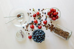 Coffe beans and berries on the table. Cups and spoons Royalty Free Stock Photo
