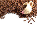 Coffe beans and cup Stock Images