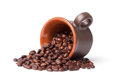 Coffe beans and cup Stock Photos