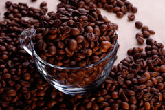 Coffe beans in glass cup Royalty Free Stock Photos